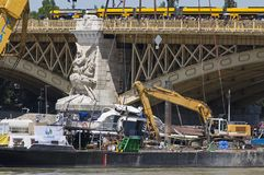Budapest, Hungary – June 11, 2019; Raising action to the surface of the sunken Hableany tour ship. Tram on the Margaret Bridge stock photos