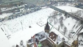 Budapest, Hungary - 4K aerial footage of drone flying over of Vajdahunyad Castle in the snowy City Park. Varosliget at winter time stock video