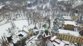 Budapest, Hungary - 4K aerial footage of drone flying over of Vajdahunyad Castle in the snowy City Park. Varosliget at winter time stock video footage
