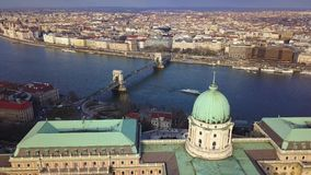 Budapest, Hungary - 4K aerial footage of drone flying up at Buda Castle Royal Palace with Szechenyi Chain Bridge and Parliament