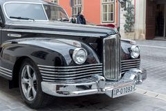 Budapest, Hungary - March 25, 2018: Black old school vintage car ZIS parked in Budapest city street royalty free stock photo