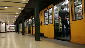 BUDAPEST, HUNGARY - 08 May. 2016: Metro train arrives at a station in Budapest. BUDAPEST, HUNGARY - 08 May. 2016: Metro train arrives at a station in Budapest stock video footage