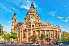 BUDAPEST, HUNGARY-MAY 04, 2016: St.Stephen Basilica in Budapest. At daytime. Side View from street with car's and people. Hungary stock image