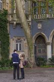 A young tourist couple at the Vajdahunyad Castle yard, also known as the Dracula castle. Stock Images