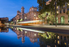 BUDAPEST, HUNGARY - OCTOBER 27, 2015: Budapest Parliament Square with Fountain water, moving tram and reflection. Stock Photo