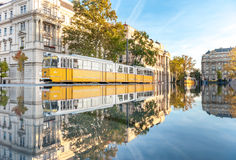 BUDAPEST, HUNGARY - OCTOBER 27, 2015: Budapest Parliament Square with Fountain water reflection going tram Ministry of Agriculture Royalty Free Stock Image