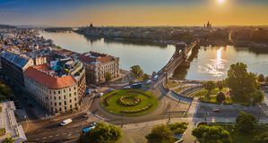 Budapest, Hungary - Panoramic aerial skyline view of Clark Adam square roundabout at sunrise. With River Danube, Szechenyi Chain Bridge and St. Stephen`s royalty free stock image