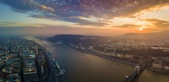 Budapest, Hungary - Panoramic aerial view of Buda Castle Royal Palace, Varkert Bazar, Gellert Hill. With Citadella and Statue of Liberty at sunset with royalty free stock photography