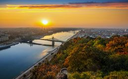 Budapest, Hungary - Panoramic skyline view of Budapest with beautiful autumn foliage, Liberty Bridge Szabadsag Hid. And lookout on Gellert Hill and colourful royalty free stock photo