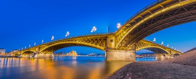 Budapest, Hungary - Panoramic skyline view of the beautiful Margaret Bridge at blue hour. With the Parliament of Hungary and other famous landmarks stock photo