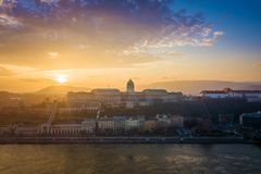 Budapest, Hungary - Panoramic skyline view of Buda Castle Royal Palace at sunset. With colorful sky royalty free stock photos