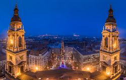 Budapest, Hungary - Panoramic skyline view of Budapest from Saint Stephens Basilica at blue hour. At winter time with christmas market Royalty Free Stock Image