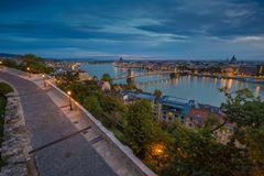 Budapest, Hungary - Panoramic skyline view of Budapest taken from Buda Castle at dawn. This view includes Chain Bridge and Parliament of Hungary and river royalty free stock photo