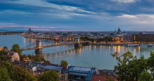 Budapest, Hungary - Panoramic skyline view of Budapest taken from Buda Castle at dawn. This view includes Szechenyi Chain Bridge, St Stephen`s basilica and Royalty Free Stock Images