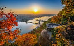 Budapest, Hungary - Panoramic skyline view of Budapest at sunrise with beautiful autumn foliage, Liberty Bridge. Szabadsag Hid and lookout on Gellert Hill royalty free stock photography