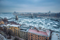 Budapest, Hungary - Panoramic skyline view of the Szechenyi Chain Bridge on the icy River Danube Stock Image