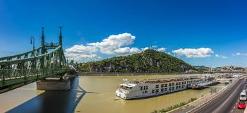 Budapest, Hungary - Panoramic view of Liberty Bridge, Gellert Hill with Statue of Liberty, the Citadel, Royal Palace Buda Castle. And other famous landmarks of stock photo