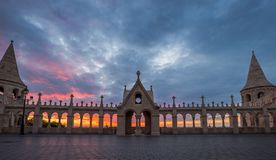 Budapest, Hungary - The Parliament of Hungary and city of Budapest throught the Fisherman`s Bastion. `s arch windows at sunrise with beautiful sky and clouds Stock Photography