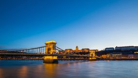 Budapest, Hungary - Skyline of Budapest with Szechenyi Chain Bridge and Buda Castle Royal Palace. At blue hour and clear blue sky royalty free stock image
