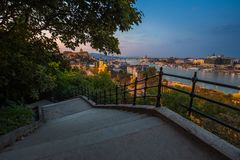 Budapest, Hungary - Staircase on the Gellert Hill. Beautiful view of Budapest at dusk with Buda Castle Royal Palace. Chain Bridge and Parliament of Hungary royalty free stock images