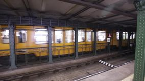 Budapest Hungary vintage old metro train stop underground. Yellow train in Budapest metro. Interior of metro station in stock video footage