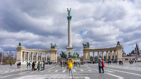 Budapest Hungary 03.15.2019. young asian woman taking selfie in heroes square royalty free stock images