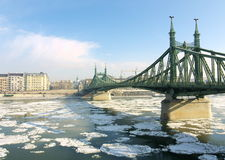 Budapest, ice drift on the Danube. Ice drift on the Danube, with the Liberty Bridge, Budapest, Hungary Royalty Free Stock Photo