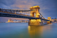 Budapest. Image of Budapest, capital city of Hungary, during twilight blue hour, with Chain Bridge in the foreground and Hungarian parliament in the background Royalty Free Stock Photography