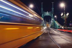 Budapest  liberty bridge. Night view at liberty bridge in Budapest with trams passing Royalty Free Stock Images