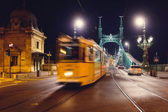 Budapest  liberty bridge. Night view at liberty bridge in Budapest with trams passing Royalty Free Stock Photos