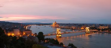 Budapest by night with Szechenyi Chain Bridge and Hungarian parliament building royalty free stock images
