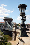 Budapest - The old chain bridge. Budapest, the capital of Hungary. It lies on both sides of the river Danube. The old Chain Bridge is one of the most remarkable Stock Photography