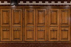Budapest old subway station on M1 yellow line interior design elements. Wooden doors and tiles in art nouveau style.  stock images