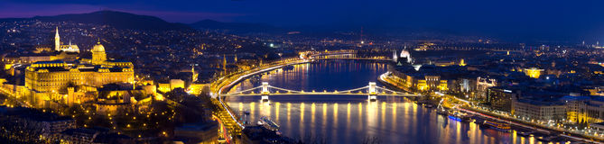 Budapest panorama at blue hour. Budapest large panorama view of the Citadel, the Matthias churc, the Chain bridge and the hungarian parlaiment Royalty Free Stock Images