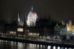 Budapest parliament building by night danub Stock Photos