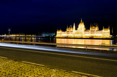 Budapest parliament building by night. Night scene in Budapest with car trails and parliament building in background Royalty Free Stock Images