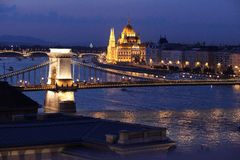 Budapest parliament and chain bridge at night Stock Photos