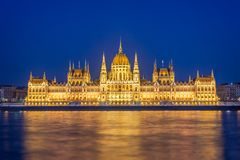 Budapest parliament illuminated at night and Danube river Hungary. Budapest parliament illuminated at night and Danube river, Hungary royalty free stock images