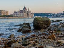 Budapest parliament and low water level. Low water level at Budapest stock photos