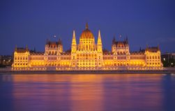 Budapest Parliament, night scene. Budapest Parliament at night with reflection in Danube river Royalty Free Stock Photos