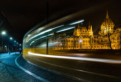 Budapest parliament at night. Night view od parliament in hungarian Budapest with passing tram in front Stock Images