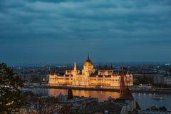 Budapest parliament night yellow illumination river bank stock photography