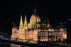Budapest parliment at night. Night time and shining Budapest parliment next toDanube river Stock Image