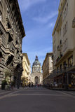 Budapest Street Scene. Scene in a street with Saint Stephens Basilica at the end of the street in Budapest Hungary Royalty Free Stock Images