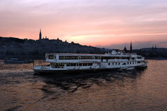 Budapest at sunset. Passenger ship on Danube river in Budapest, at sunset Royalty Free Stock Photos