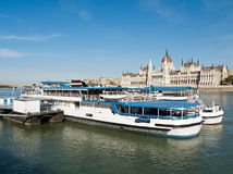 Budapest, tourist boats with the Parliament buildi Stock Photo