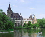 Budapest Vajdahunyad Castle. Vajdahunyad Castle in Budapest public park with lake in fornt Royalty Free Stock Images