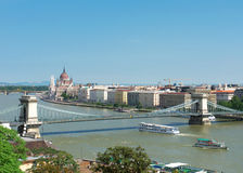 Budapest view. Chain bridge with boats gliding over the Danube Stock Photography