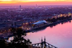 Budapest whale. Glass building on the riverside sunrise, in orange and purple lights Royalty Free Stock Photography
