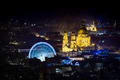 Budapest wheel. Night view at St Stephen basilica and wheel in Budapest Royalty Free Stock Image
